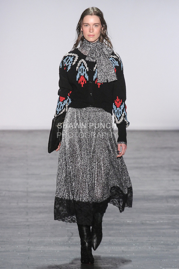 "Model Eliza walks runway in a merino wool cardigan with cross stitched embroidery in black, with crystal pleated lame skirt with scalloped lace hem in gunmetal, from the Vivienne Tam Fall Winter 2016 ""Cultural Dreamland The New Silk Road"" collection, presented at NYFW: The Shows Fall 2016, during New York Fashion Week Fall 2016."