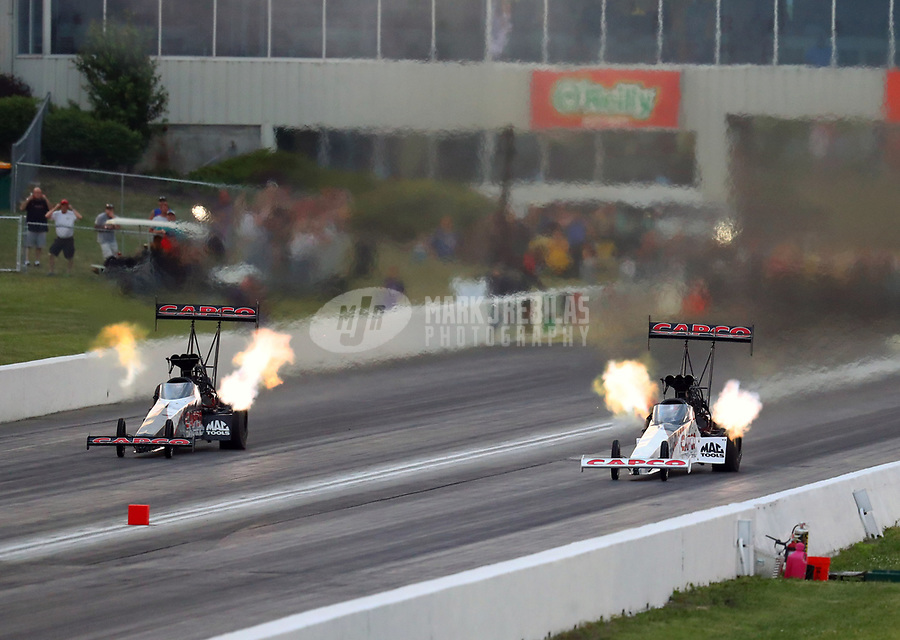 May 18, 2018; Topeka, KS, USA; NHRA top fuel driver Billy Torrence (left) races alongside son Steve Torrence during qualifying for the Heartland Nationals at Heartland Motorsports Park. Mandatory Credit: Mark J. Rebilas-USA TODAY Sports