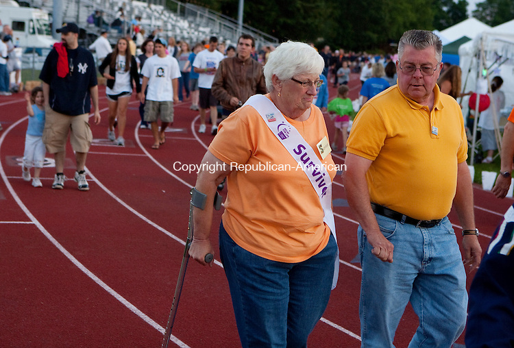 CHESHIRE, CT 11 JUNE, 2010-061110JS09- Cancer survivor Geri Hawks of Southbury walks with her husband Donald Hawks as they circle the track at Cheshire High School on Friday on the opening day of the annual Relay for Life. Hawks, a five year survivor of breast cancer, also has multiple sclerosis and walks in both the Relay for LIfe and the Walk MS. The walk continues through today (Saturday).<br /> Jim Shannon Republican-American