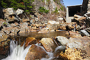 Crawford Notch State Park - Saco River in the White Mountains, New Hampshire USA during the spring months. The Saco River travels under Route 302 in a tunnel from its starting point, Saco Lake, and exits here. From this point it makes it way through the notch