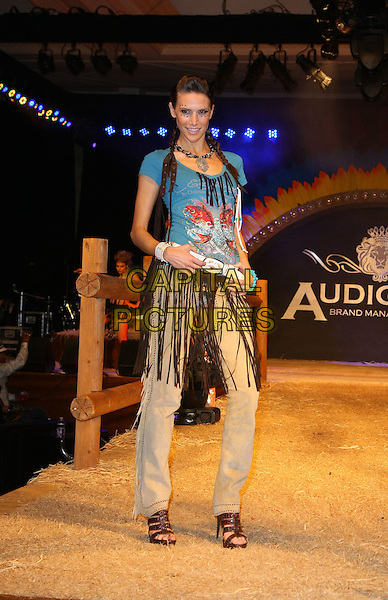 "CHRISTIAN AUDIGIER MODEL.Christian Audigier presents ""When I Move You Move The Trade Show"" Day Two held at Caesar's Palace Resort Hotel and Casino, Las Vegas, Nevada, USA..February 17th, 2009.fashion catwalk full length native american indian jeans denim tassel blue black.CAP/ADM/MJT.© MJT/AdMedia/Capital Pictures."