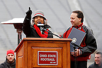 Congresswoman Joyce Beatty and Congressman Pat Tiberi address the crowd during the celebration for winning the national championship at Ohio Stadium on Jan. 24, 2015. (Adam Cairns / The Columbus Dispatch)