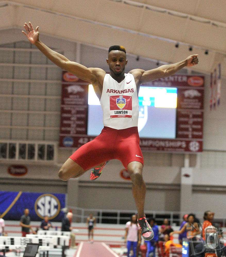 NWA Democrat-Gazette/MICHAEL WOODS &bull; @NWAMICHAELW<br /> Arkansas long jumper Jarrion Lawson lands a jump in the mens long jump Friday, February 26, 2016 at the at the 2016 SEC Indoor Track and Field Championships at the Randal Tyson Track Center in Fayetteville.  To see more photos from this event visit nwadg.com/photos