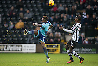 Anthony Stewart of Wycombe Wanderers clears from Jonathan Forte of Notts County during the Sky Bet League 2 match between Notts County and Wycombe Wanderers at Meadow Lane, Nottingham, England on 10 December 2016. Photo by Andy Rowland.