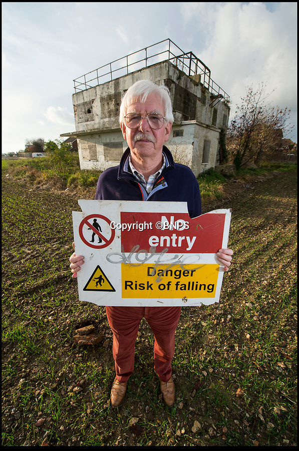 BNPS.co.uk (01202 558833)<br /> Pic:PhilYeomans/BNPS<br /> <br /> Dudley Hooley - Director of Tangmere Aviation Museum, who is leading the fight to save the historic control tower.<br /> <br /> A campaign has been launched to restore a historic Second World War airfield control tower which has fallen into an alarming state of disrepair.<br /> <br /> RAF Tangmere in West Sussex was one of Britain's most important airfields during the Battle of Britain and was the base of double amputee flying ace Douglas Bader.<br /> <br /> It closed down in 1970 and most of its buildings were knocked down to create room for houses.<br /> <br /> Sadly, all that remains of the iconic watch tower today is a dilapidated shell covered in graffiti in the middle of an overgrown field.
