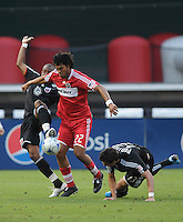 Chicago Fire defender William Conde (22) fights for possession of the ball against DC United midfielder Rodney Wallace (22) .  DC United defeated the Chicago Fire 2-1  at  RFK Stadium, Saturday June 13, 2009.