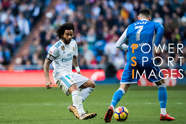 Marcelo Vieira Da Silva (L) of Real Madrid tackles Lucas Perez Martinez of RC Deportivo La Coruna during the La Liga 2017-18 match between Real Madrid and RC Deportivo La Coruna at Santiago Bernabeu Stadium on January 21 2018 in Madrid, Spain. Photo by Diego Gonzalez / Power Sport Images