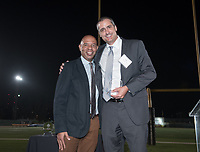 "Basketball player Blair Slattery '94 receives his recognition. Blair Slattery '94 is Occidental's all-time career scoring (1,676 points) and rebounding (1,034) leader in men's basketball. The 6'7"", 225-pound forward later played pro ball for five years in Europe, averaging 22 points and 17 rebounds per game in leading Germany's Munster Basketball Club to a 34-2 record in his first season.<br /> The Occidental community celebrates its student-athletes with the induction of the sixth class into the Occidental College Athletics Hall of Fame during Homecoming and Family Weekend on Friday, Oct. 13, 2017 in Jack Kemp Stadium. The 2017 inductees are Stephen Haas '63 (track and field), the 1982 women's tennis team (NCAA national champions), Blair Slattery '94 (basketball and tennis), and the late Andy Collins '07 (football, track and field).<br /> (Photo by Marc Campos, Occidental College Photographer)"