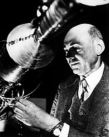 "Undated File Photo - Robert Goddard, a pioneer in rocket development, received patents for a multi-stage rocket and liquid propellants in 1914 and published a paper describing how to reach extreme altitudes six years later. That paper, ""A Method of Reaching Extreme Altitudes,"" detailed methods for raising weather-recording instruments higher than what could be achieved by balloons and explained the mathematical theories of rocket propulsion. The paper, which was published by the Smithsonian Institution, also discussed the possibility of a rocket reaching the moon -- a position for which the press ridiculed Goddard. Yet several copies of the report found their way to Europe, and by 1927, the German Rocket Society was established, and the German Army began its rocket program in 1931.<br /> <br /> Goddard, meanwhile, continued his work. By 1926, he had constructed and tested the first rocket using liquid fuel. Goddard's work largely anticipated in technical detail the later German V-2 missiles, including gyroscopic control, steering by means of vanes in the jet stream of the rocket motor, gimbal-steering, power-driven fuel pumps and other devices.<br /> <br /> Image credit: NASA"