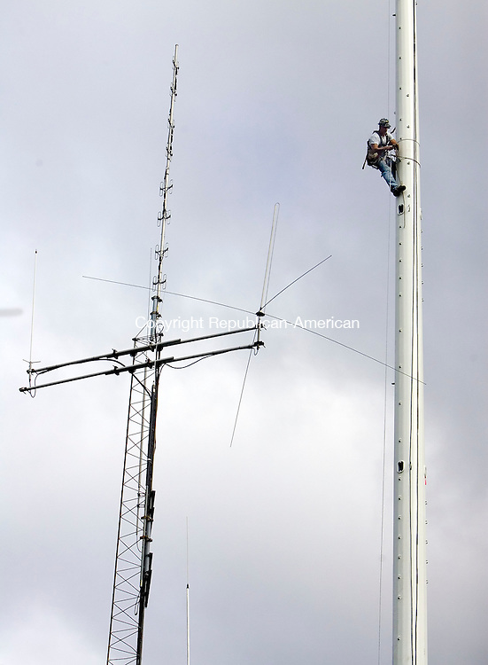 WOLCOTT, CT- 29 SEPTEMBER 2008- 092908JT02-<br /> At the approximate height of the old radio tower, Kevin Quick, of Northeast Towers out of Farmington, assembles Wolcott's new communicatioins tower on Monday behind Town Hall. The tower is part of a $3 million project that includes a new communications center for the town's emergency response system.<br /> Josalee Thrift / Republican-American