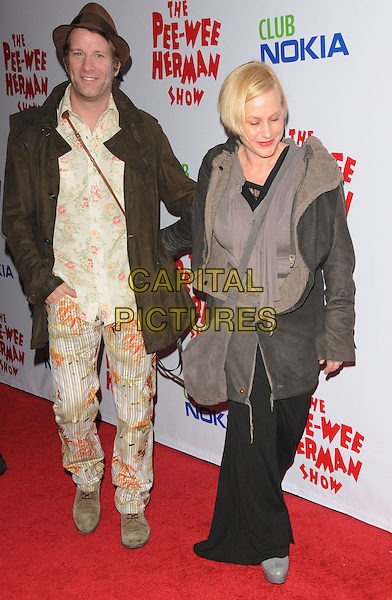 THOMAS JANE & PATRICIA ARQUETTE.The The Pee-Wee Herman Show Opening Night held at Club Nokia at L.A. Live in Los Angeles, California, USA..January 20th, 2010.full length married husband wife brown grey gray jacket trousers cream floral print hat satchel fashion disaster dress.CAP/RKE/DVS.©DVS/RockinExposures/Capital Pictures.