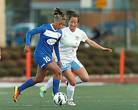 Boston Breakers forward Lianne Sanderson (10) dribbles as Chicago Red Stars defender Jackie Santacaterina (18) pressures. In a National Women's Soccer League Elite (NWSL) match, the Boston Breakers (blue) defeated Chicago Red Stars (white), 4-1, at Dilboy Stadium on May 4, 2013.