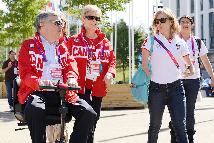 LONDON, ENGLAND 09/08/2012  The Lieutenant Governor of Ontario David Onley with his wife Ruth Ann during a tour of the Athlete's Village with Elisabeth Walker-Young at the London 2012 Paralympic Games.  (Photo by Matthew Murnaghan/Canadian Paralympic Committee)