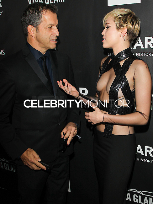 HOLLYWOOD, LOS ANGELES, CA, USA - OCTOBER 29: Kenneth Cole, Miley Cyrus arrive at the 2014 amfAR LA Inspiration Gala at Milk Studios on October 29, 2014 in Hollywood, Los Angeles, California, United States. (Photo by Celebrity Monitor)