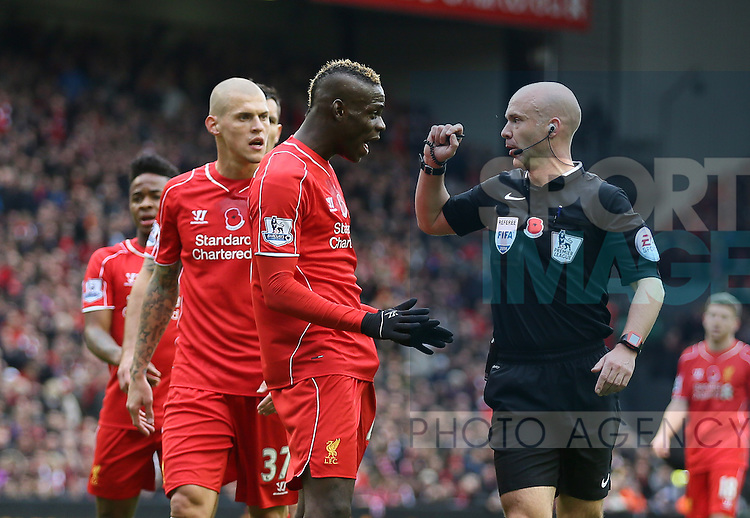 Mario Balotelli of Liverpool confronts referee Anthony Taylor  - Barclays Premier League - Liverpool vs Chelsea - Anfield Stadium - Liverpool - England - 8th November 2014  - Picture Simon Bellis/Sportimage