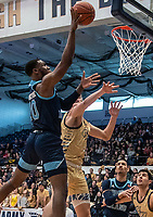 WASHINGTON, DC - FEBRUARY 8: Cyril Langevine #10 of Rhode Island shoots over Chase Paar #3 of George Washington during a game between Rhode Island and George Washington at Charles E Smith Center on February 8, 2020 in Washington, DC.