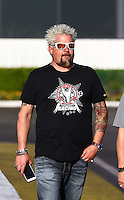 Feb 8, 2015; Pomona, CA, USA; Television cook Guy Fieri in attendance during NHRA eliminations at the Winternationals at Auto Club Raceway at Pomona. Mandatory Credit: Mark J. Rebilas-USA TODAY Sports