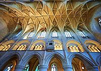 The Aisle of the 12the century early transitional Norman architecture of the parish church of St Peter & St Paul part of Malmesbury Abbey, Wiltshire, England