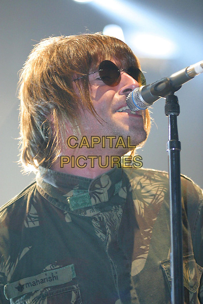 OASIS - LIAM GALLAGHER.Live In Germany.live, concert, stage, singing, camouflage, army, headshot, portrait, sunglasses, shades.Ref: F2F.www.capitalpictures.com.sales@capitalpictures.com.© Capital Pictures