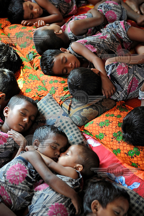 Children whose parents are too poor to send them to school sleep at a shelter run by a local NGO, supported by Dutch NGO Terre des Hommes.