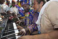 "Ethiopia. Southern Nations, Nationalities, and Peoples' Region. Karat village. Konso tribe. Marc Vella is a french musician and a nomadic pianist. Over the last 25 years he has travelled with his Grand Piano in around forty countries to celebrate humanity. Thanks to the variacordes which he has devised, his piano music is unique. Creator of ""La Caravane amoureuse"" (The Caravan of Love) he takes people with him to say ""I love you"" to others and ""lovingly conquered"" their hearts and souls. Marc Vella and Poqalla Tuna Kalla play an improvised duet-playing - one piano and four hands. The Poqalla is a clan head considered as a direct descendant of the first Konzo. The Konso, also known as the Konzo, are a Cushitic-speaking ethnic group. They are agriculturists. Although the Konso people have many customs dating back hundreds of years, it is not uncommon for them to be seen wearing western clothing. The Omo Valley, situated in Africa's Great Rift Valley, is home to an estimated 250,000 individuals of the Konso tribe. Southern Nations, Nationalities, and Peoples' Region (often abbreviated as SNNPR) is one of the nine ethnic divisions of Ethiopia 7.11.15 © 2015 Didier Ruef"