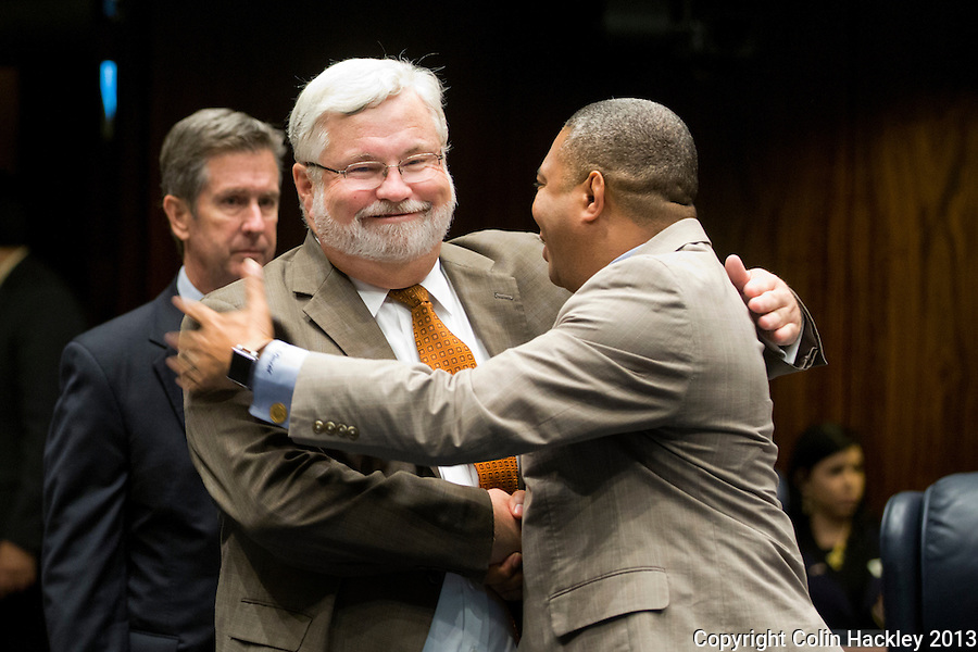TALLAHASSEE, FLA. 5/3/13-SESSIONEND050313CH-Sen. Jack Latvala, R-Clearwater, left, is congratulated on the passage of the election reform bill by Sen. Christopher Smith, D-Fort Lauderdale, during the final day of the legislative session May 3, 2013 at the Capitol in Tallahassee...COLIN HACKLEY PHOTO