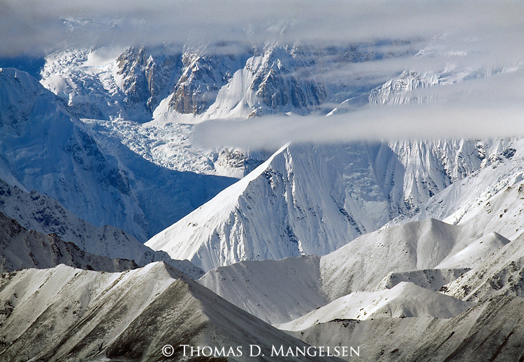 Clouds descend on the ridges and peaks of the Alaska Range in Denali National Park, Alaska.