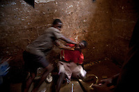 Two juvenile prisoners start a fight after gambling over a game of checkers in Pademba Central Prison.
