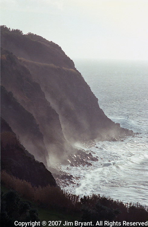 Waves batter a cliff line on Terceira, Azores. Far out in the Atlantic Ocean, some 850 miles off the western coast of Lisbon, Portugal lies the 425-mile long archipelago of the Azores. (Jim Bryant Photo).....