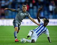 Lincoln City's Harry Anderson is tackled by Huddersfield Town's Trevoh Chalobah<br /> <br /> Photographer Andrew Vaughan/CameraSport<br /> <br /> The Carabao Cup First Round - Huddersfield Town v Lincoln City - Tuesday 13th August 2019 - John Smith's Stadium - Huddersfield<br />  <br /> World Copyright © 2019 CameraSport. All rights reserved. 43 Linden Ave. Countesthorpe. Leicester. England. LE8 5PG - Tel: +44 (0) 116 277 4147 - admin@camerasport.com - www.camerasport.com