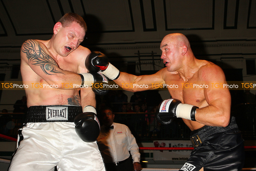 Butch Lesley (black shorts) defeats Igoris Borucha in a Cruiserweight boxing contest at York Hall, Bethnal Green, promoted by Left Jab - 04/03/11 - MANDATORY CREDIT: Gavin Ellis/TGSPHOTO - Self billing applies where appropriate - 0845 094 6026 - contact@tgsphoto.co.uk - NO UNPAID USE.