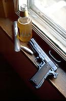 Still life of Colt .45 pistol, joint, beer, bag of marijuana  model released.  St Paul Minnesota USA