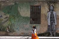 street scene with wall painting,  in Havana, Cuba