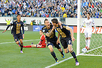 Sebastien Le Toux (9) of the Philadelphia Union celebrates scoring the first goal of the game with Danny Califf (4) in the fourth minute during a Major League Soccer (MLS) match against D. C. United at Lincoln Financial Field in Philadelphia, PA, on April 10, 2010.