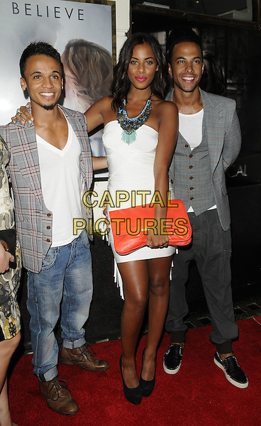 """ASTON MERRYGOLD, ROCHELLE WISEMAN & MARVIN HUMES.""""Ghost The Musical"""" press night, Piccadilly Theatre, Denman St., London, England..July 19th, 2011.full length white dress strapless silver blue turquoise beads red clutch bag beaded necklace grey gray jacket waistcoat couple The Saturdays JLS  check jeans denim.CAP/CAN.©Can Nguyen/Capital Pictures."""