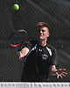 Sandy Greenberg of Half Hollow Hills East returns a volley from Cameron Klepper of Hills West (not in picture) in the second singles match of the Suffolk County varsity boys tennis team championship at Half Hollow Hills High School East on Wednesday, May 17, 2017.