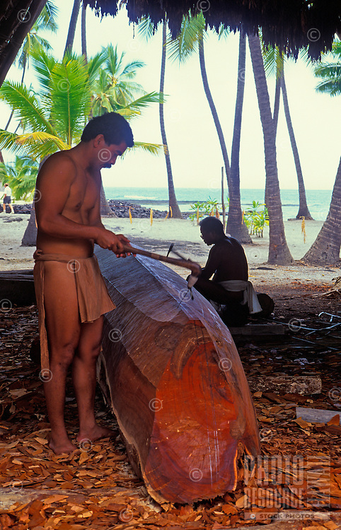Two menworking on crafting a boat, city of refuge (Puu Honua o Honaunau)