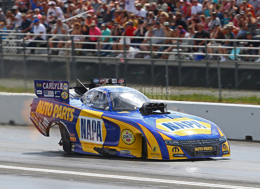 Jun 4, 2016; Epping , NH, USA; NHRA funny car driver Ron Capps during qualifying for the New England Nationals at New England Dragway. Mandatory Credit: Mark J. Rebilas-USA TODAY Sports