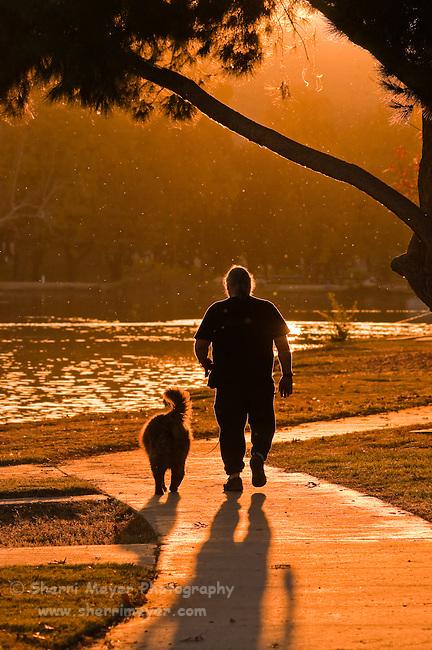 Man walking his dog at Hart Memorial Park, Bakersfield, California.