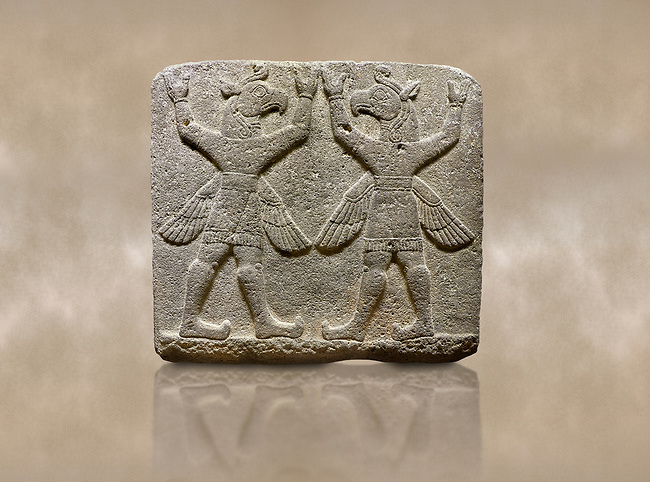 """Hittite relief sculpted orthostat stone panel of Herald's Wall Basalt, Karkamıs, (Kargamıs), Carchemish (Karkemish), 900-700 B.C. Bird-headed, winged figures of human body. Anatolian Civilisations Museum, Ankara, Turkey.<br /> <br /> These figures are called as """"Winged Griffin Demons"""". Embossing is constructed symmetrically. Their hands are on their heads. It is assumed that they carry the heavens. <br /> <br /> Against a brown art background."""