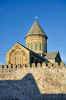 Pictures &amp; images of the exterior and wall around the Eastern Orthodox Georgian Svetitskhoveli Cathedral (Cathedral of the Living Pillar) , Mtskheta, Georgia (country). A UNESCO World Heritage Site.<br /> <br /> Currently the second largest church building in Georgia, Svetitskhoveli Cathedral is a masterpiece of Early Medieval architecture completed in 1029 by Georgian architect Arsukisdze on an earlier site dating back toi the 4th century.