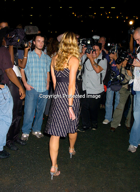 Denise Richards..at The Tommy Hilfiger Fashion Show for Spring 2005 at ..The Tents on September 9, 2004...Photo by Robin Platzer, Twin Images