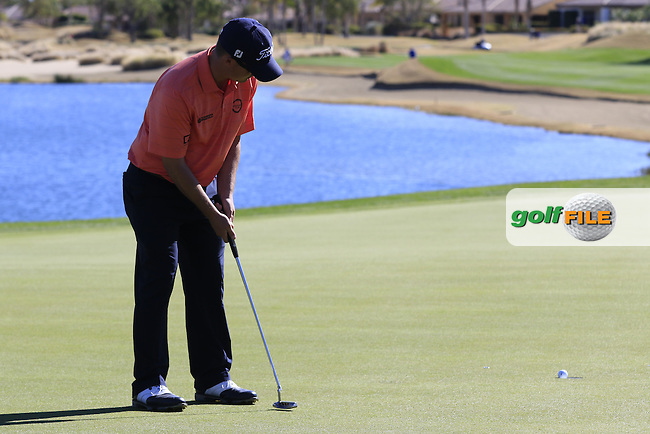 Chris Evans (USA) putts on the 18th green during Saturday's Round 3 of the 2017 CareerBuilder Challenge held at PGA West, La Quinta, Palm Springs, California, USA.<br /> 21st January 2017.<br /> Picture: Eoin Clarke | Golffile<br /> <br /> <br /> All photos usage must carry mandatory copyright credit (&copy; Golffile | Eoin Clarke)