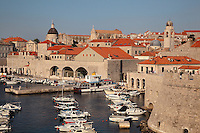 The old harbour of the medieval walled city, Dubrovnik, Croatia, developed by architect Paskoje Milicevic in the 15th century. The city developed as an important port in the 15th and 16th centuries and has had a multicultural history, allied to the Romans, Ostrogoths, Byzantines, Ancona, Hungary and the Ottomans. In 1979 the city was listed as a UNESCO World Heritage Site. Picture by Manuel Cohen