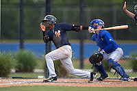 New York Yankees Abiatal Avelino (22) at bat in front of catcher Dan Jansen (16) during a minor league spring training game against the Toronto Blue Jays on March 24, 2015 at the Englebert Complex in Dunedin, Florida.  (Mike Janes/Four Seam Images)