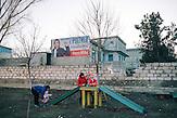 Wahlplakt für Irina Vlah, die prorussische, sozialistische Favoritin bei der Governeurswahl am  22.03.2015 l in  Gagusien,   hier auf einem Kinderspielplatz in der kleineren Stadt Toma., Die Republik Moldau ist eines der ärmsten Länder EuropasPromotional poster for Irina Vlah next to the children playground at Tomai village