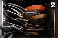 Stack of saucepan inside oven (Licence this image exclusively with Getty: http://www.gettyimages.com/detail/sb10066852m-001 )