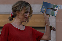 """Sonia Bergamasco (Actress) reading Alessandro Leogrande's Book """"La Frontiera"""" (The Border).  <br /> <br /> Rome, 27/07/2020. Today, hundreds of people, NGO's (ONG) representatives, actors and politicians gathered in Piazza San Silvestro (near the Italian Parliament) to protest (1.) against the dramatic situation in Libya - erupted in a civil war between the GNA (2.) and the forces of General Khalifa Belqasim Haftar - and to protest against the inhumane conditions of migrant people trapped in legal and illegal prisons in Libya. The aim of the demo was to call the Italian Government to stop funding the """"Libyan Coast Guard"""" and to immediately help and free People in Libya throughout """"Humanitarian Corridors"""", and give them the protection they are entitled of by the International Human Rights Conventions.<br /> From the organisers Facebook event page: «[…] we meet to ask the Italian Government and the European States to stop funding the so-called Libyan coast guard, to close and evacuate the detention centres by transferring migrants out of Libya and to promote corridors to help people on the run find protection without endangering their lives. The men, women and children who take the sea from the Libyan coast flee from situations of extreme misery, despotic regimes, tribal persecutions, ethnic conflicts, wars and environmental catastrophes. And in Libya they are subjected to violence, extortion, detention, torture, rape and torture. A few days ago, on July 16, the Chamber of Deputies [Of the Italian Parliament, ndr] for the fourth consecutive year approved the financing of the Italian mission in Libya, which provides financial support for the so-called Libyan coastguard and training and training of its members. […] The mobilization will be accompanied by readings by Ascanio Celestini, Valentina Carnelutti, Fabrizio Gifuni and Sonia Bergamasco[…]».<br /> <br /> Footnotes & Links:<br /> 1. http://bit.do/fG3Eu<br /> 2. 07.05.19 Prime Minister of Libya Fayez al-Serraj Met I"""