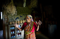 Seed bank manager, Bijadidi explains seeds and conservation in the seed bank in Dr. Vandana Shiva's farm in Dehradun, Uttarakhand, India on 5th September 2009. ..61 year old Bija Devi, affectionately known as Bijadidi, is the 'seed bank expert', and has worked with the organization since it was founded. She's known for her knowledge of indigenous seeds. ..Dr. Vandana Shiva is a physicist turned environmentalist who campaigns against genetically modified food and teaches farmers to rely on indigenous farming methods.. .Photo by Suzanne Lee / For The National