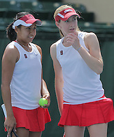 STANFORD, CA - April 9, 2011:  Stacey Tan and Carolyn McVeigh talk strategy during Stanford's 5-2 victory over Washington at Stanford, California on April 9, 2011.